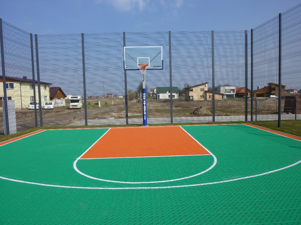 What is the coating made on sports fields 42