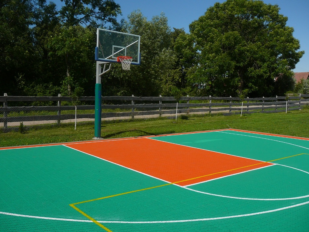 What is the coating made on sports fields 25